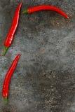 Pimienta de chile candente en fondo del grunge Imágenes de archivo libres de regalías
