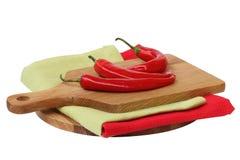 Pimienta de chiles rojos en el fondo blanco Imagenes de archivo