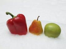 Pimienta, pera, manzana y nieve Fotografía de archivo libre de regalías