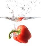 Pimienta roja, paprika en chapoteo del agua Imagen de archivo libre de regalías