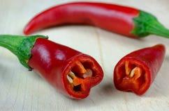 Pimienta roja y una sección cortada Fotografía de archivo libre de regalías