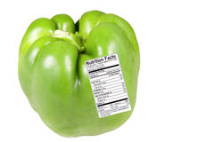 Pimienta verde con la escritura de la etiqueta de la nutrición Foto de archivo libre de regalías