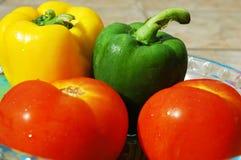 Pimienta y tomate imagenes de archivo