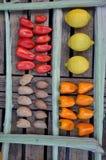 Pimientas, almendras y limones en una tabla Imagenes de archivo