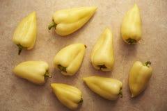 Pimientas amarillas en la sobremesa Fotografía de archivo