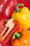 Pimientas anaranjadas y amarillas rojas Imagen de archivo libre de regalías
