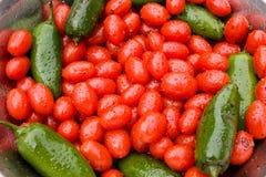 Pimientas calientes y tomates de cereza Foto de archivo libre de regalías
