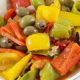 Pimientas, cebollas, tomates y aceitunas Imágenes de archivo libres de regalías