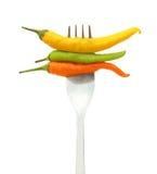 Pimientas de chile en fork Fotografía de archivo