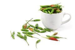 Pimientas de chile en taza Foto de archivo