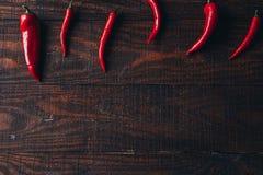 Pimientas de chile en un fondo de madera Imagen de archivo