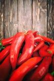 Pimientas de chile en una tabla Foto de archivo libre de regalías