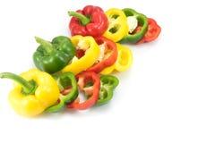 Pimientas dulces coloridas brillantes aisladas en blanco Foto de archivo libre de regalías