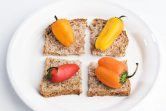 Pimientas en el pan Imágenes de archivo libres de regalías