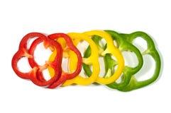 Pimientas rojas, amarillas y verdes rebanadas Imagen de archivo libre de regalías