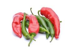 Pimientas rojas y pimientas de chile Imágenes de archivo libres de regalías