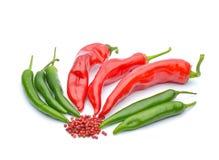 Pimientas rojas y pimientas de chile Foto de archivo