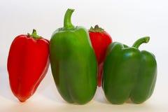 Pimientas verdes y rojas Fotos de archivo libres de regalías