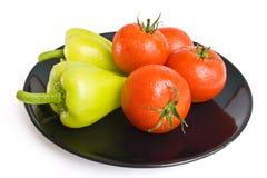 Pimientas y tomates Fotografía de archivo libre de regalías