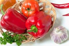 Pimientas y tomates Fotos de archivo libres de regalías