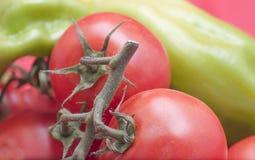 pimientas y tomates Imágenes de archivo libres de regalías