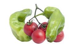 Pimientas y tomates aislados Imagen de archivo libre de regalías