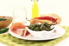Pimientos de padron with ham Stock Images