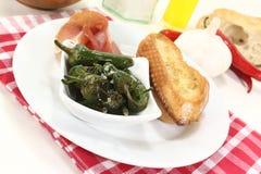 Pimientos de padron and nut ham Stock Photo