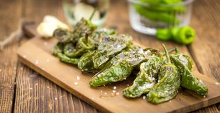 Fresh made Pimientos de Padron on a rustic background Royalty Free Stock Images