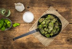 Pimientos de Padron on wooden background; selective focus Royalty Free Stock Photography
