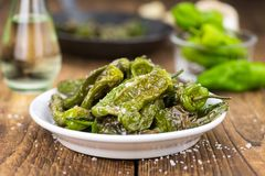 Pimientos de Padron on wooden background; selective focus Stock Photography