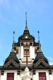 Pináculo de Lohaprasada del acero en un templo tailandés Fotografía de archivo libre de regalías