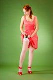 Pin样式性感的红头发人女孩 免版税库存照片