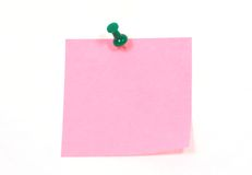 Pin. Isolated green paper pin and paper on white stock photography