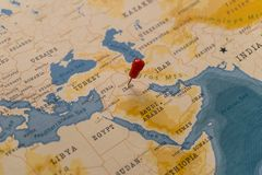 A pin on baghdad, iraq in the world map royalty free stock photo