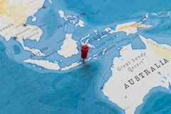 A pin on bali, indonesia in the world map.  royalty free stock photo