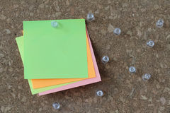 Pin board and blank sticky note on cork board Stock Photos