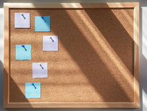 Pin board for notes. Morning light. Bright morning light from the window, the work of freelancing, success and motivation Royalty Free Stock Photo
