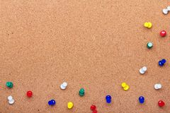 Pin board texture for background and colorful pins frame stock photo