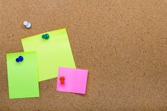 Pin board texture for background, corolful pins and sticky notes. Copy space stock image