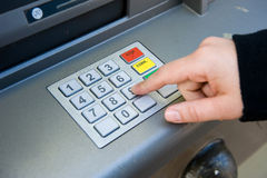 Pin code at ATM machine Stock Images