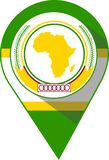 Pin in the colour of the African Union flag royalty free stock photo