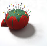 Pin cushion. Tailor's red tomato pin cushion on white background Stock Images