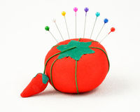 Pin Cushion. Tomato pin cushion with a crown of pins royalty free stock photography