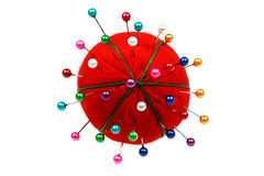 Pin Cushion. Red stuffed pin holding cushion isolated white background stock photo