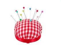 Pin cushion. With pins over white background royalty free stock image