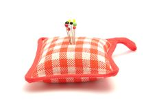 Pin cushion. With several pins stock photography