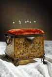 Pin Cushion. Antique sewing casket with pins in cushion royalty free stock images