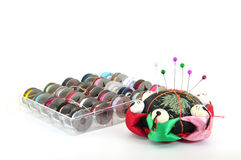 Pin cushion with bobbins Royalty Free Stock Image