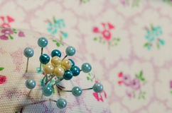 Pin cushion. With green and yellow pins Stock Photos
